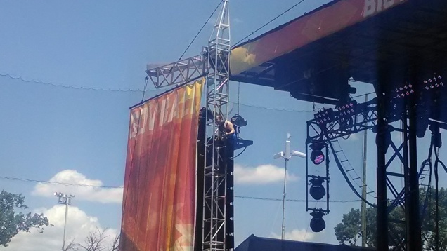 One of Diarrhea Planet's four guitar players takes a solo from the scaffolding at the Governors Ball Music Festival